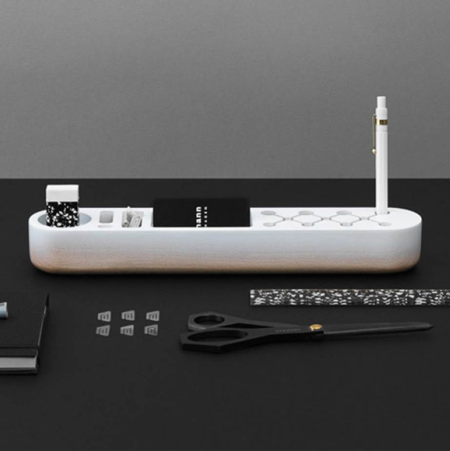 """For the man who like nifty design, Normann Copenhagen's One Piece Desk Organiser is just the thing for a tidy desk. $125, [from Design Stuff>(https://www.designstuff.com.au/normann-copenhagen-one-piece-desk-organizer-white/
