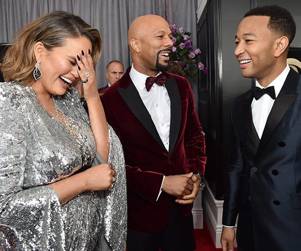 Chrissy shares a giggle with Common and John.