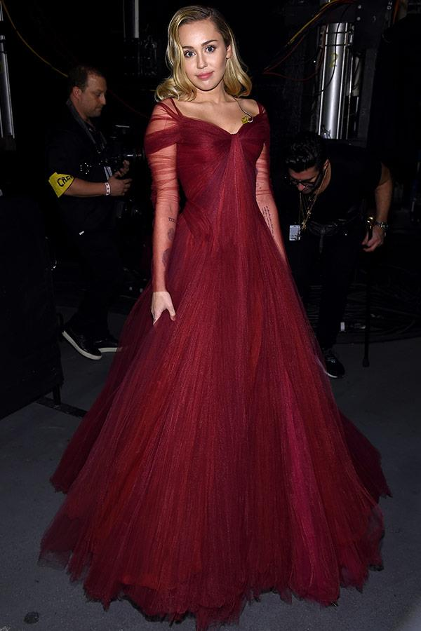 Lady in red! Miley is a vision in this Zac Posen creation.