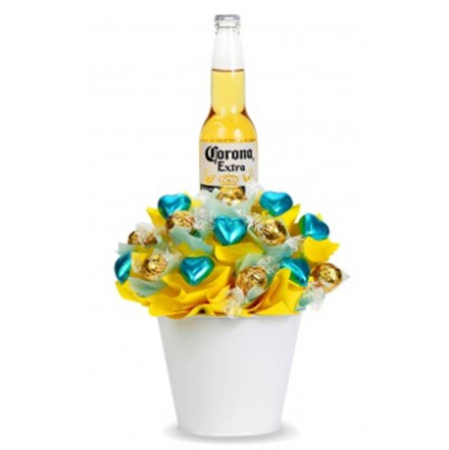 """For the man who loves a beer bucket. Yes, it's chocolate and a little bit cheesy, but for those who want to surprise their partner with a fun delivery, the Summer Feels Corona Bucket is just the thing. $48, [from Tastebuds>(https://www.tastebuds.com.au/summer-feels-bucket