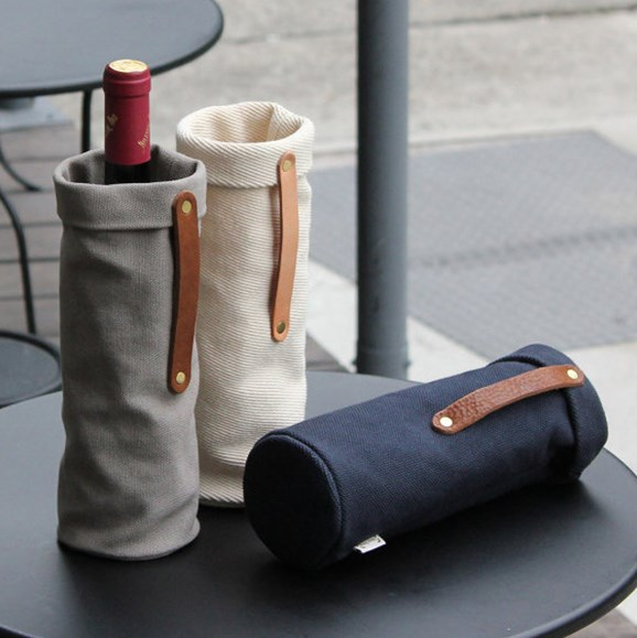 """For the man who likes a fine drop and a trendy tote. This wine holder looks great en route or just in the home. $42.12, 1 Day 1 Bag, [from Etsy>(https://www.etsy.com/au/listing/202283386/minimalist-wine-gift-bag-leather-wine?ga_order=most_relevant&ga_search_type=all&ga_view_type=gallery&ga_search_query=canvas%20wine%20holder&ref=sc_gallery-1-4&plkey=9b2cf2ce4010820e7835e0122660fbbc61cc5ad1:202283386