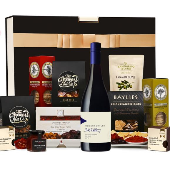 """Red Wine and Nibbles Hamper, $99, from [The Hamper Emporium](https://www.thehamperemporium.com.au/gift-hampers/red-wine-nibbles/