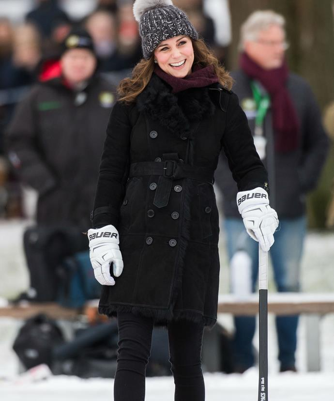Kate, who will soon welcome her third little prince or princess, kept warm in a shearling-lined coat from Burberry.