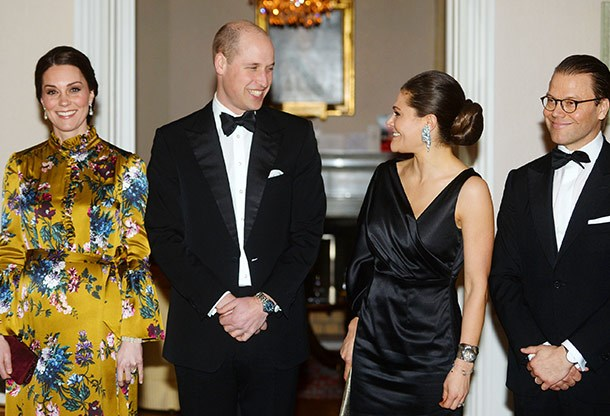 A royal night out! The couples share a laugh.