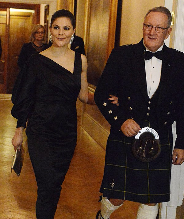Princess Victoria opted for a black satin frock with a ruffled sleeve.