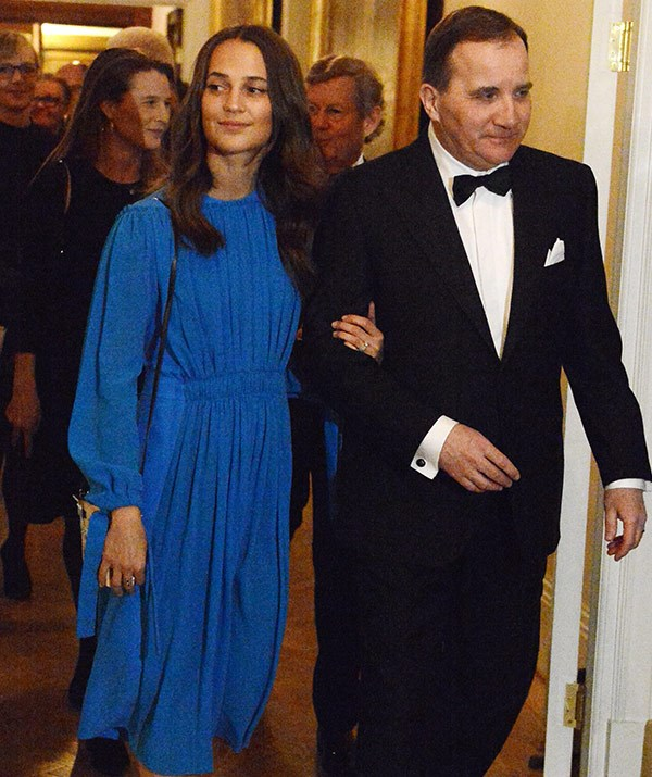 Swedish actress Alicia Vikander is escorted by Prime Minister Stefan Lofven.