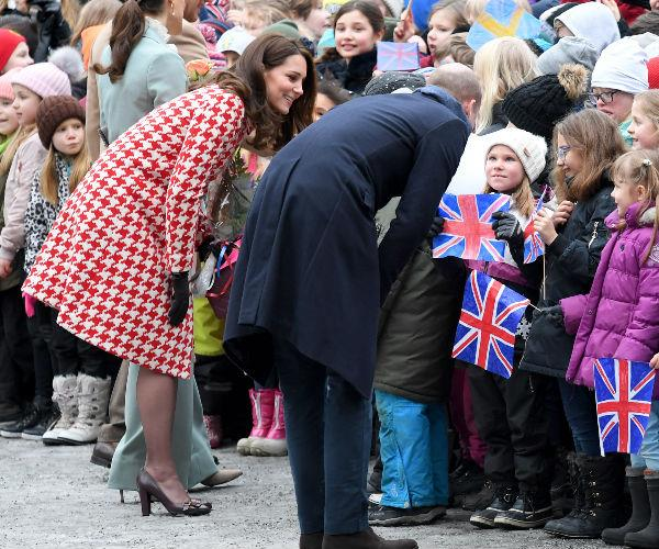The Duke and Duchess extended what was meet to be a quick wave and walk-by to speak with many children that had waited patiently to catch a glimpse of their time in Sweden.