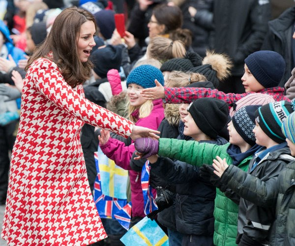 Kate, who is six months pregnant with her third child, doled out the handshakes...