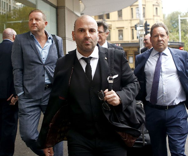 George Calombaris has won his appeal against a conviction for assaulting a teenage soccer fan.