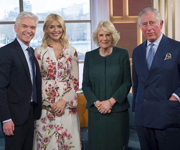 Breakfast TV gets a royal make over. The royal couple pose with the show's host Holly Willoughby and Phillip Schofield.