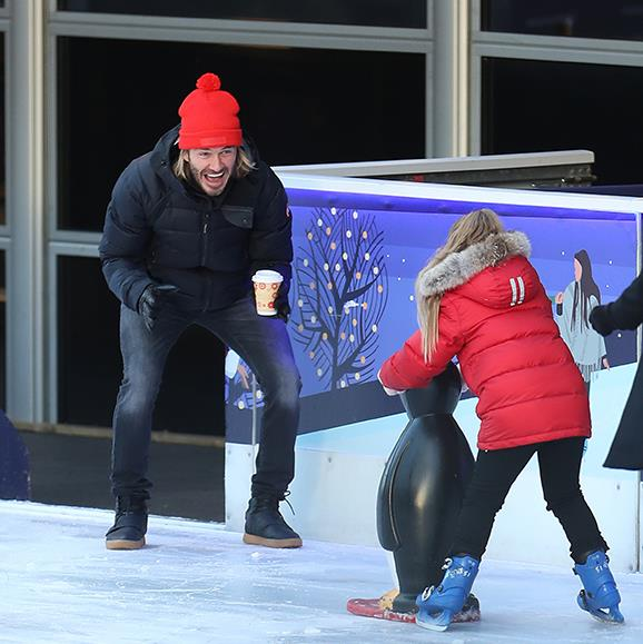 Doting dad David excitedly cheers on Harper, 6, as she takes to her skates on the Natural Museum ice rink in London.