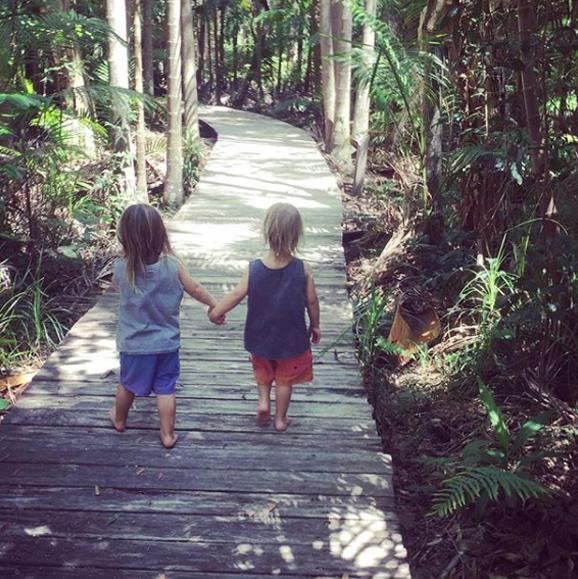 "Be still our beating hearts - look at these two! Proud dad Chris posted this sweet snap of his mini-mes to Instagram with the caption: ""My son said to his brother 'Tristan hold my hand so you don't get eaten by a crocodile' #mykids #littlelegends @australia #byronbay."""