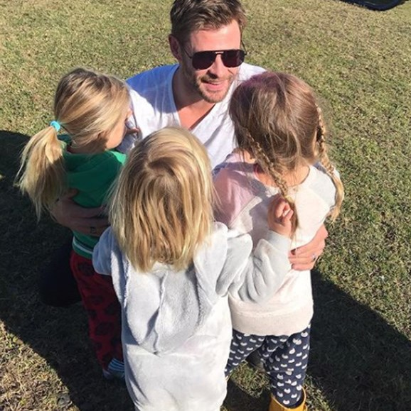 "India, 5, and three-year-old twins Sasha and Tristan smother dad Chris in cuddles on his return home. ""Papa is back!!"" The tiny clans' mum captioned the cute pic."