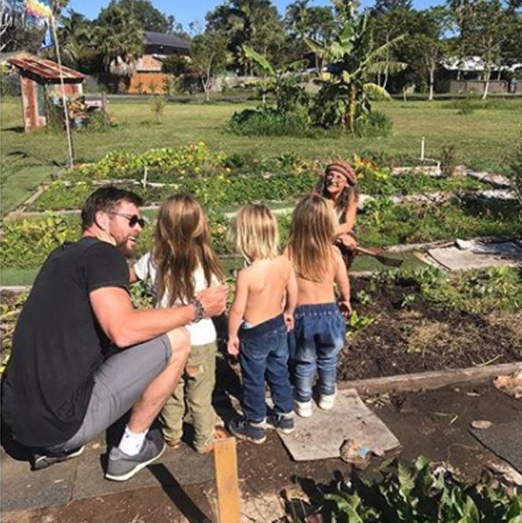 They're a down-to-earth family. Chris brushes the kids' up on some gardening skills.