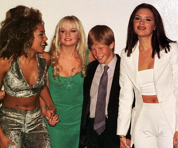 Spicing up the royal wedding? Prince Harry pictured with the girl group in 1997.