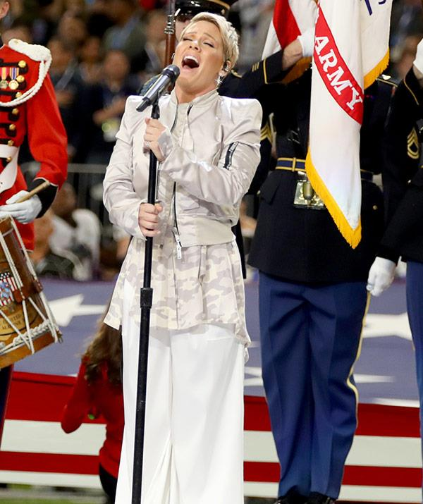 Despite battling the flu, the 38-year-old nailed her performance of the National Anthem. **WATCH: The star takes out her throat lozenge like a boss! Post continues**