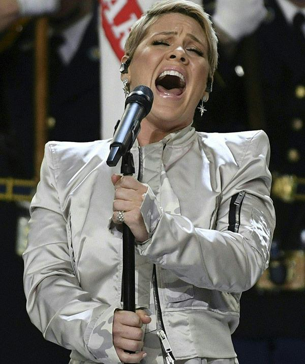 """Not missing a beat, Pink replied to the troll: """"Yeah but at least I suck while singing our countries national anthem, and you just suck by yourself on a dirty couch. #winning."""""""