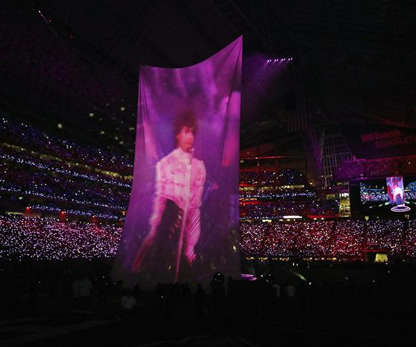 An image of the Prince was projected as JT sun the late star's classic hit, *I Would Die 4 U*.