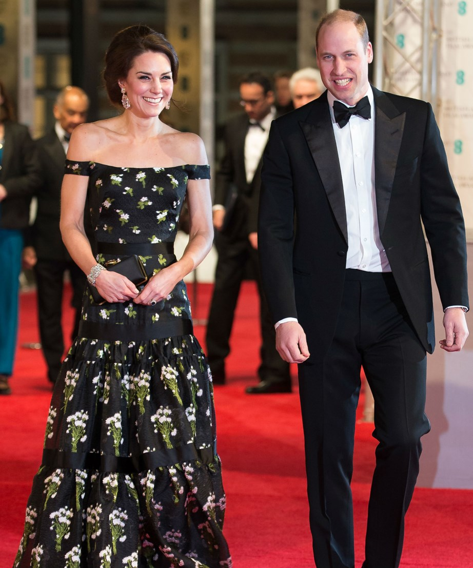 Catherine braved the cold at last year's BAFTAs with an off-the-shoulder gown embellished with green and violet flowers, and satin ribbon detailing.