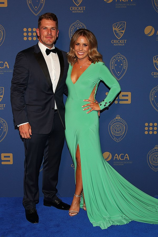 Aaron Finch and his stunning fiancée Amy Griffith's in a green Jason Grech gown.
