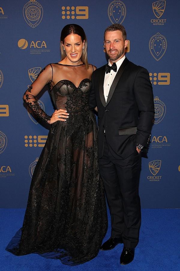Matthew Wade's wife, Julia dared to bare a little skin in a sheer Oglialoro Couture gown.