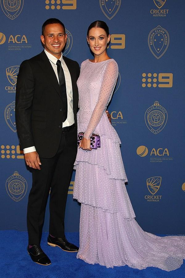 Usman Khawaja's fiancée, Rachel McLellan, wore a pretty lavender tired-gown by Jason Grech.