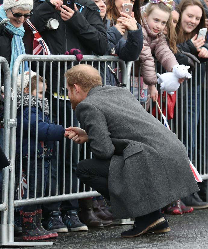 We just can't get enough this photo, which shows Prince Harry shaking the hand of a little girl during the walkabout outside Edinburgh Castle.