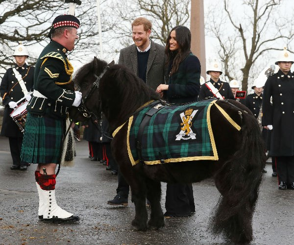 Upon arrival, the newly-engaged couple were greeted by the Band of Royal Marines and their mascot, an adorable Shetland pony named Cruachan.