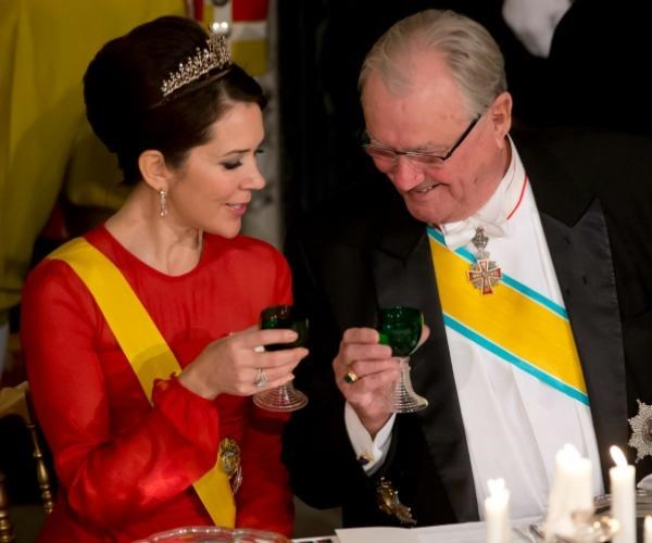 Princess Mary and her father-in-law share a toast.
