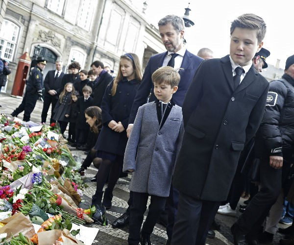 Prince Frederik, Prince Christian, Prince Vincent and Princess Isabella are pictured as they view tributes left by members of the public.