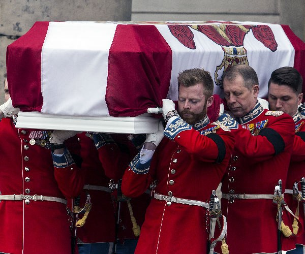 Hundreds of mourners lined the streets to watch military officers carry away Prince Henrik's coffin, draped in a Danish flag with his personal coat of arms.