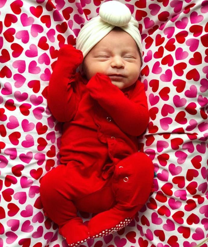 """Minnie begged me to take a photo [of her] on the blanket grandma (my mom) made for her!!! #ValentinesBaby,"" Minnie's mama Lisa captioned this cute pic."
