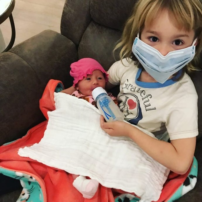 """A nurse has got to do what a nurse has got to do! #SafetyFirst #FluSeason #BigSisterDuty,"" Lisa captioned this pic of Minnie and her older sister Pearl."