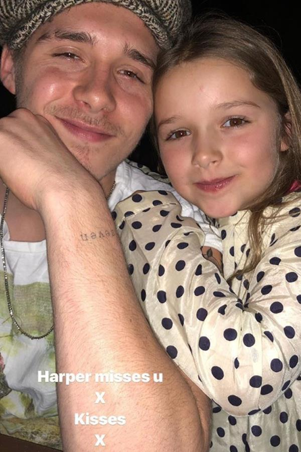 Eldest Beckham child Brooklyn, 18, took a break form his studies in New York to visit his family during London Fashion Week. Here he poses with the gorgeous baby of the family, Harper, who according to Victoria misses her big brother.