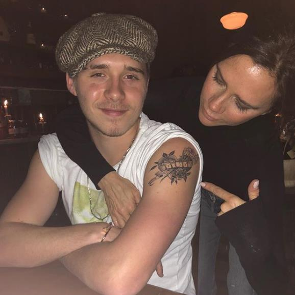 While back in town visiting his family, Brooklyn showed off his newest tattoo, a dedication to his fashion designer mum. Victoria clearly approved of her son's new ink, she posted this proud shot to Instagram.