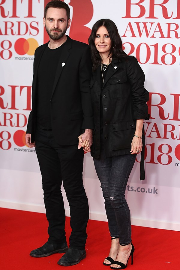 Courteney Cox, 53, and her fiance Irish singer Johnny McDaid, 41, couple-dressed in black for the night.