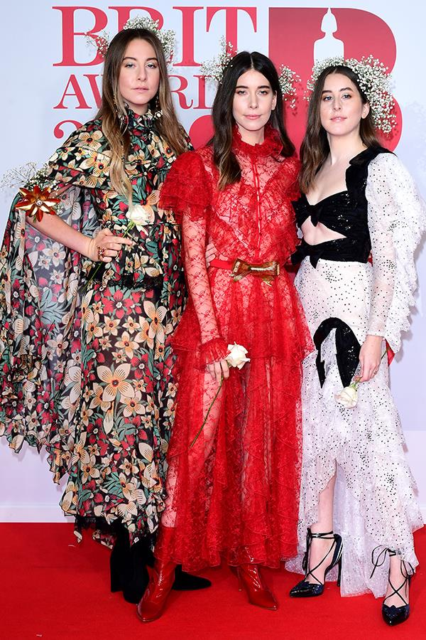 Sister act! The American sibling rock trio, Haim, looked as though they stepped out of the pages of a fashion magazine and onto the red carpet in their stunning lace gowns.