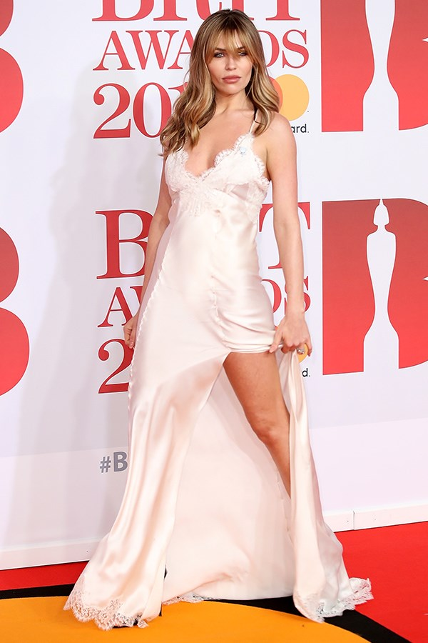 British model Abbey Clancy slipped into in a slinky negligee gown boasting an impressive thigh split.