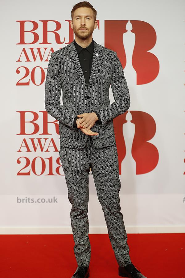 Calvin Harris looked fresh from a summer holiday. The British DJ glowed in a patterned monochrome suit.