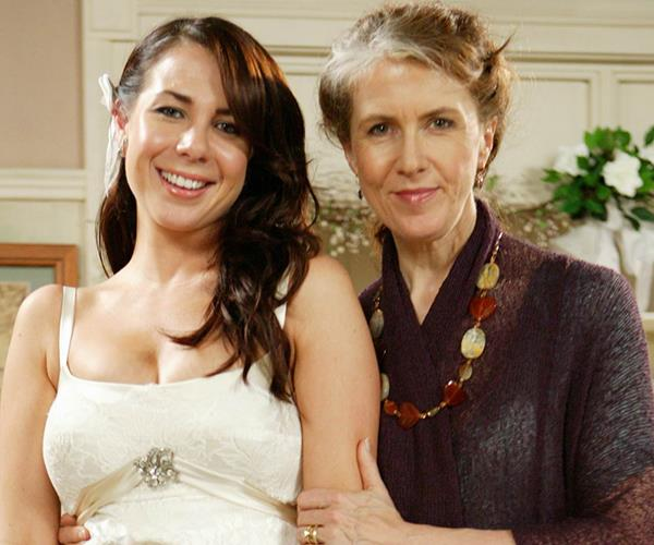 Debra as Pippa in *Home and Away* with co-star Kate Ritchie.