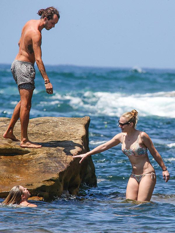 The couple splash about.