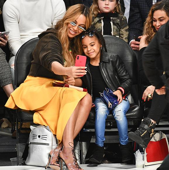 Say cheese! Beyonce and Blue Ivy pose for a selfie video court-side at the NBA All-Star game in Los Angeles, California.