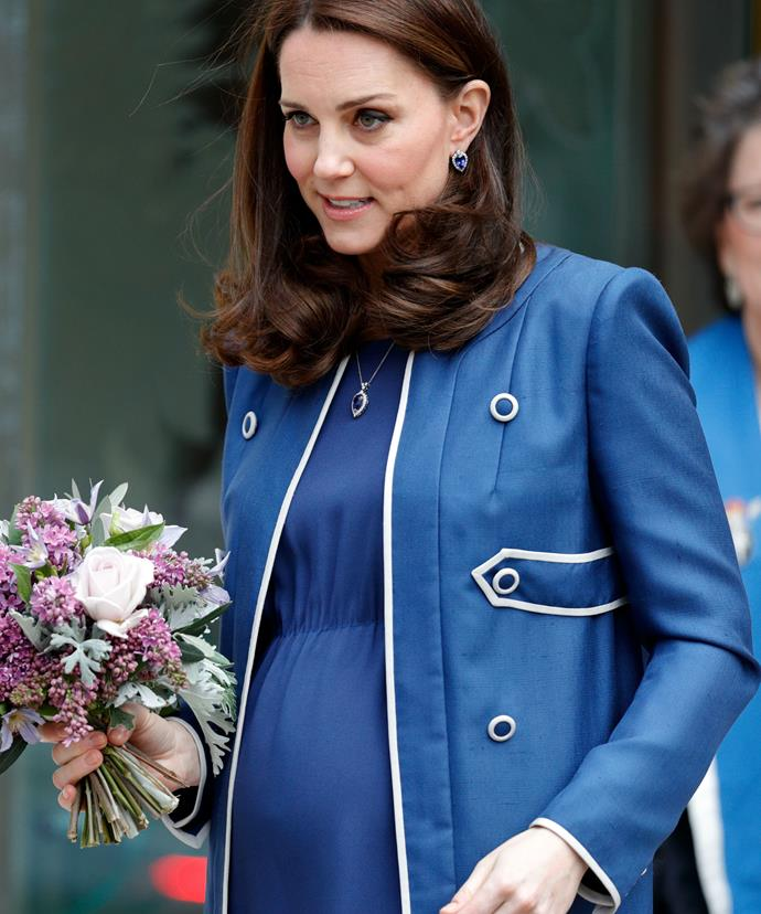Kate, who is expecting her third child in April, kept her growing baby bump cozy in a custom-made Jenny Packham military-inspired coat.