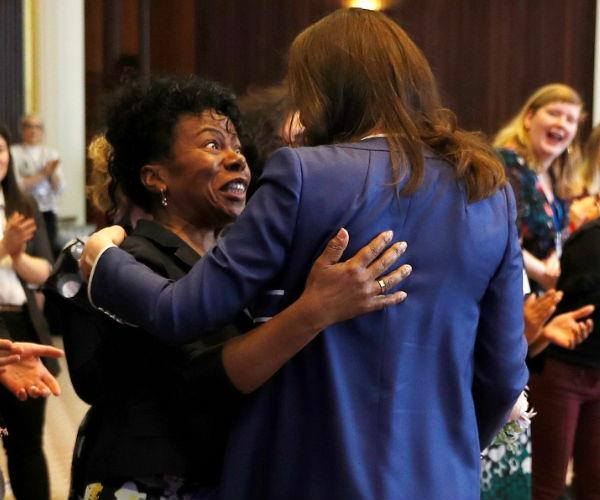 While at the Royal College of Obstetricians and Gynaecologists (RCOG), the Duchess shared a sweet reunion with Professor Dunkley-Bent, who assisted with the delivery of Princess Charlotte.