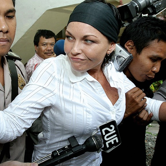 Schapelle Corby is escorted by police to a court in Denpasar, on Bali island, August 2006.