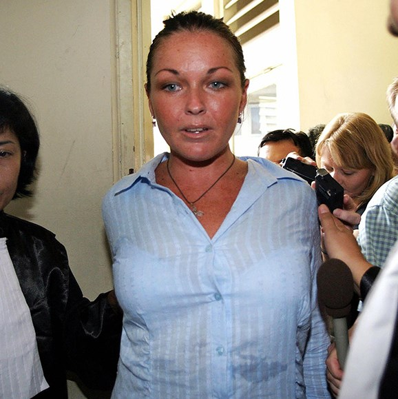 Schapelle Corby is escorted by prosecutors into a court room before her trial in Denpasar, on Bali Island, January 2005.