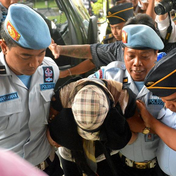 Schapelle Corby is escorted by police and prison officials at the prosecutor's office after she was freed from prison on parole.