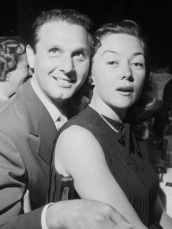 Gloria with with Cy Howard.