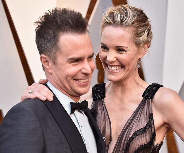 Best Supporting Actor nominee Sam Rockwell shares an adorable moment with Leslie Bibb.