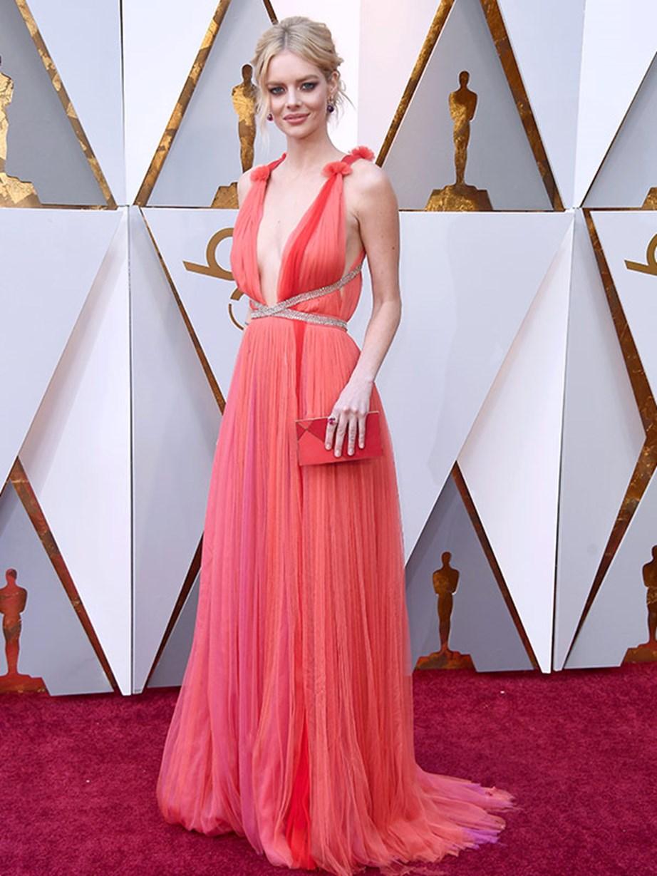 Australian actress Samara Weaving looks like a Grecian goddess in this dreamy peach ensemble. Will her film *Three Billboards Outside Ebbing, Missouri* win the Best Film gong?